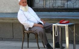 White shirt, red phone (Dushanbe, Tajikistan) by Kate B Dixon